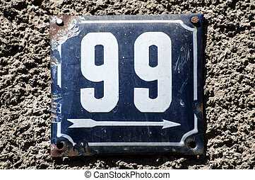 Weathered enameled plate number 99