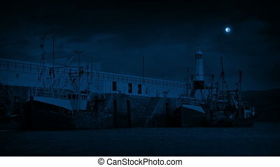 Weathered Fishing Boats In The Harbor At Night