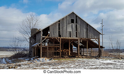 weathered old barn in winter