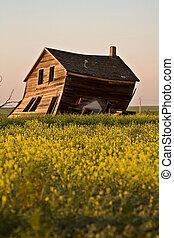 Weathered old farm house in scenic Saskatchewan