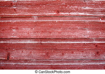 Weathered red barn board.