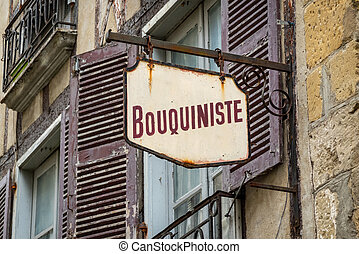 Weathered retro bookstore sign in France