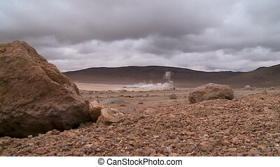 Weathered Rocks And Geysers In Atacama, Bolivia - Wide...