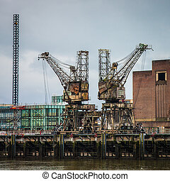 Weathered rusty cranes - Weathered rusty industrial coal...