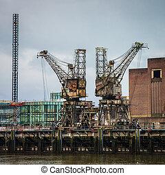 Weathered rusty industrial coal cranes in Chelsea London