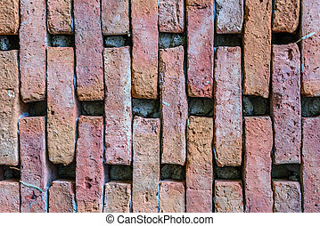 Weathered stained old brick wall background.