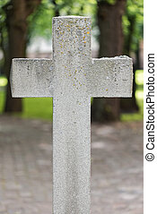 Weathered stone cross at old cemetery