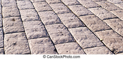 stone paved road with perspective. background, texture.