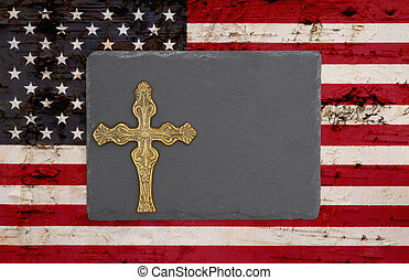 Weathered United States of America flag with a black chalkboard with a cross
