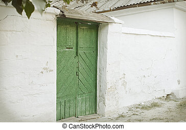 weathered wall with green door in retro style
