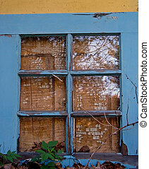 Weathered blue window with crackled paint