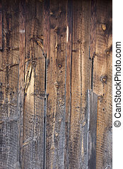 weathered wood background - old barn wall with a different exposure to elements