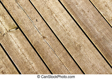 Weathered wood decking planks close up.