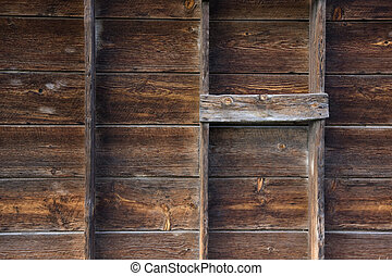 old barn wall with verical posts - weathered wood background with grid pattern