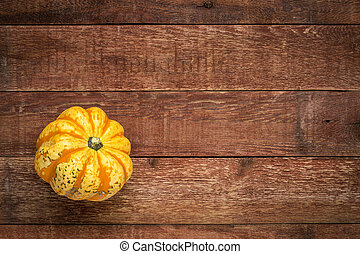 weathered wood with winter squash - weathered plank barn...