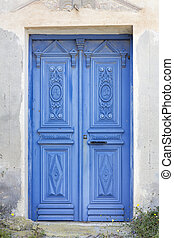 Weathered wooden door in Greece, Europe