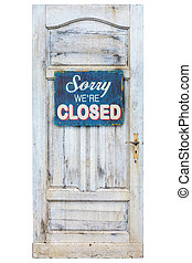 Weathered wooden door with closed sign