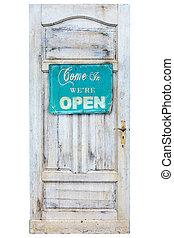 Weathered wooden door with welcome sign