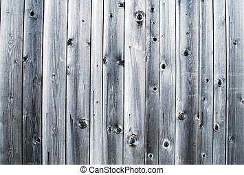 weathered wooden panels on a facade of a barn