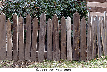 Weathered wooden picket fence corner