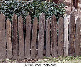 Weathered wooden picket fence
