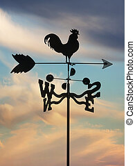 iron weathervane against cloudscape