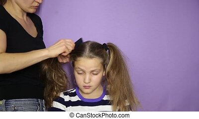Weave a little cute girl pigtails. The Barber makes a girl hairstyle.