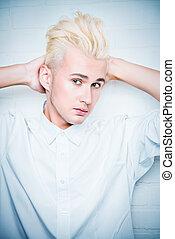 weave hair - Beautiful young man with sensual look posing at...