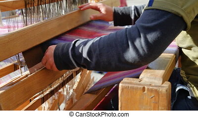 Weaver  with old loom