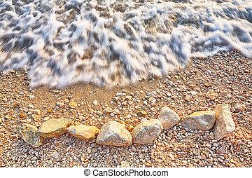 Weaves on seashore on beautiful beach of Gradac in Makarska riviera.