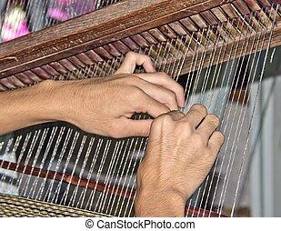 Weaving hands - Hands weaving a rug