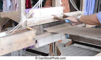 Weaving loom - Woman working at weaving loom