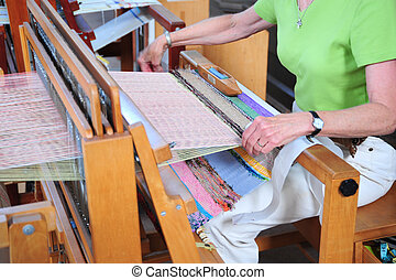 Weaving machine. - Cloth being weaved in a weaving machine.
