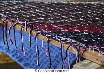 weaving on an old loom