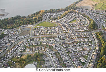 Weaving Roads through Suburban Development - Aerial view of...
