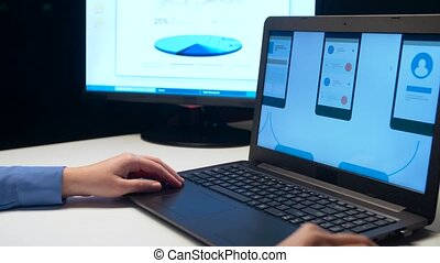 web designer with laptop working at night office - web...