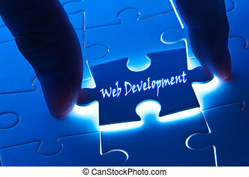 Web development word on puzzle piece with back light