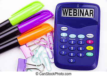 Webinar text in the office with surroundings such as marker, pen writing on calculator. Business concept for Online Training Development Business Workshop white background with copy space