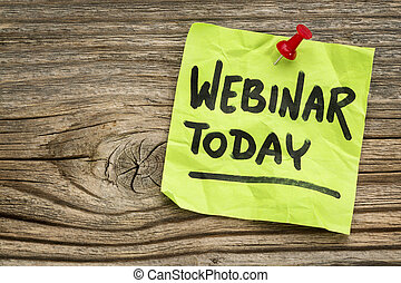 webinar today reminder - handwriting on a green sticky note against grained and knotted wood board