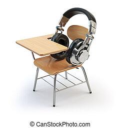 Webinar training or audiobooks  concept. E-learning education online. Headphones and schooldesk isolated on white.