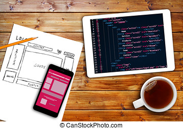 website wireframe sketch and programming code on digital...