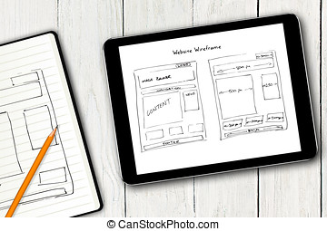 website wireframe sketch on digital tablet screen