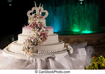 Wed Cake - a classy white wedding cake with a fountain in...