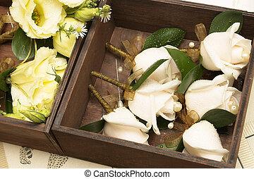 Wedding #16 - Wedding - corsages in a brown wooden holder