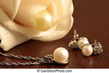 Wedding #24 - Wedding Jewelry on a dark wooden table, with...