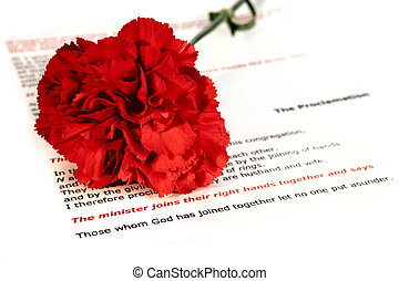 Wedding 3 - A red carnation on the order of service for a ...