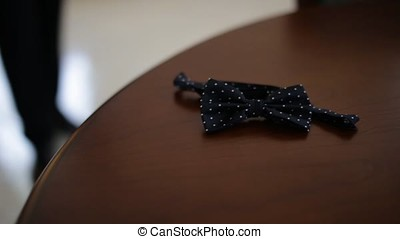 Wedding accessories. Bow tie in the hands of the groom. Man...