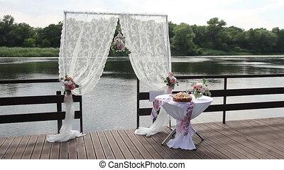 wedding arch for registration near the pier