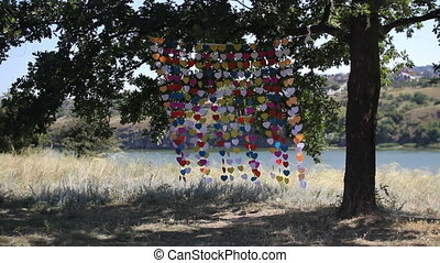 Wedding arch made of hearts on a string sway in the wind