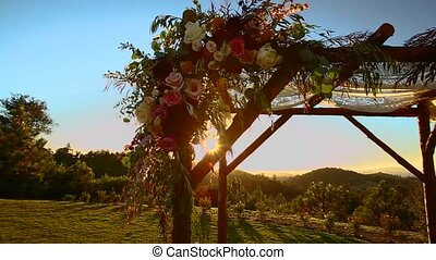 Wedding arrangement pan of canopy at sunset - Jewish...